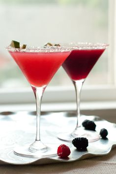 Raspberry Daiquiri Recipe  -  Ingredients:    10 raspberries  1/2 ounce orange liqueur   2 ounces rum  1/2 teaspoon raw sugar  one lime, juiced  Prepare your glass by running a lime wedge around the rim of a martini glass. Dip the top of the glass into a plate sprinkled with sugar.  In a mixing glass, muddle the raspberries with the lime juice and sugar.  Add rum and lots of ice. Shake well.  Pour the mixture through a sieve into a martini glass. The sieve helps catch the raspberry seeds.