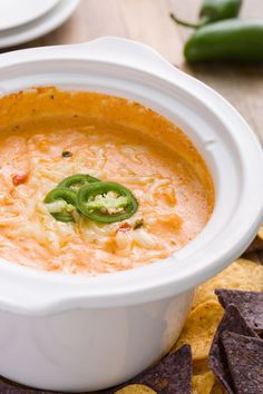 Everything you love about a chicken enchilada turned into one creamy-ass dip. Enchilada sauce and grated pepper jack combine to create a thick queso-like sauce you won't be able to stop snacking on. Get the recipe from Delish.   - Delish.com