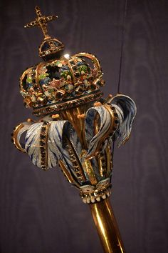 A enameled scepter in the shape of a lily flower. In the royal treasury at Rosenborg Castle, Denmark. The scepter was made for the coronation of King Frederick III in 1648 and is gold with enameled ends and decorated with diamonds. The scepter symbolizes the supreme earthly power of the king.