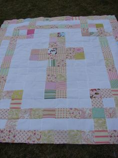 Cross Quilt Tutorial. I absolutely love this quilt, and with some extra border it could be made larger for a full or queen bed.