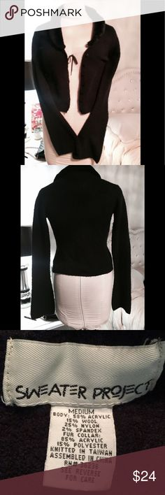 """SWEATER PROJECT BLACK SWEATER SZ M BELL SLEEVES Super cute! Pre owned, gently worn. Very good condition. NO holes or stains. Smoke free home. Collar buttons off. Button front. Wool Nylon Spandex Blend. Faux fur collar. Great stretch fit. Definitely can work as a small to medium. Armpit to armpit flat side to side: 18"""" sleeve length from armpit to bottom: 24"""" shoulder to shoulder at widest: 16 1/2"""" length from top of shoulder to bottom:  20""""   Smoke free home and environment. Sweater Project…"""