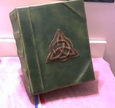 These are made to order and will take 4-5 weeks to produce and ship.    To watch a flip-through video of this book, click here: https://www.youtube.com/watch?v=1uqBt6S4qLU  This is a handmade Book of Shadows. I bind the cover with painted faux leather and the cover has a raised, interlocking triquetra.  This book features 500 aged pages (250 sheets). 320 of them are printed pages, and there are 180 blank pages for you to add your own spells and entries. The pages are held in place by screws…