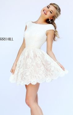 You will never go out of style in Sherri Hill 32257. This gorgeous cocktail dress features a bateau neckline with low v-back. The splendid lace covers allover the dress and styled with fabulous scalloped hem at mid-thigh length.