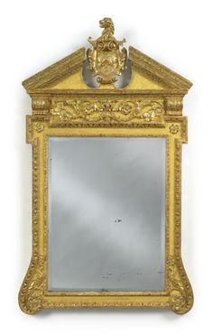 A George II giltwood and Gilt-Gesso pier mirror circa 1735 the cartouche with the arms of Higden.  The reverse with original partial paper label inscribed S. JEN..NG... / Carver & Gilder / Looking glafses & Picture Frames.../.../ with all Mouldings...ready and joined.../... height 4 ft. 9 in.; width 34 in.