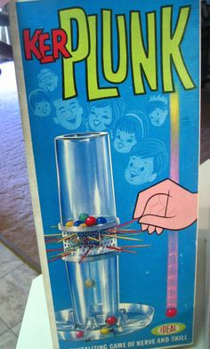 Kerplunk - a game of nerve and skill with sharp sticks and marbles bouncing on plastic. We were easily amused.
