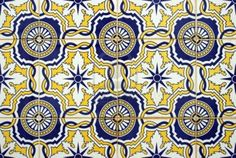 Vintage tiles on the outside of old houses in Southern Portugal Stock Photo - 4317776
