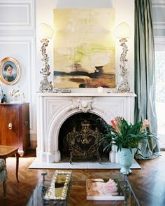 Fireplace Arch Photo - A marble mantel surrounded by blue walls and curtains
