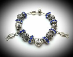 Check out this item in my Etsy shop https://www.etsy.com/listing/210610943/colon-cancer-charm-bracelet-awareness