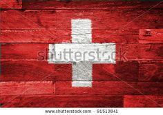 stock photo : switzerland flag painted on old wood background