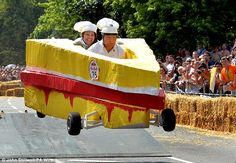 Wacky racers battle it out in a sandwich, bottle of brown sauce and a Lego racecar in crazy soapbox derby