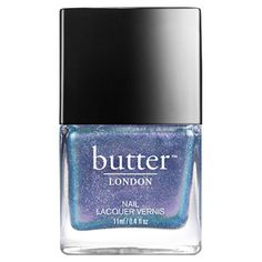 A twinkling oyster shell overcoat nail lacquer
