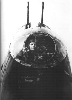 kruegerwaffen:  A RAF bomber aimer peers down from the flat perspex viewing panel in the front panel of a Lancaster bomber.