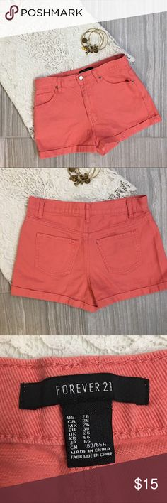 Forever 21 High Rise shorts Size 26 Forever 21 High Rise Shorts. Size 26. Coral Denim. Cuffed hem. No distressing on fabric. Excellent used condition. No stains, marks, rips holes or tears. No visible signs of wear. Listing is for shorts only. Lace top is by Forever 21 and is available in another of my listings. Bundle and save with bundle discounts and combining shipping. Accessories used for styling and not for sale. Forever 21 Shorts Jean Shorts