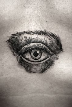 #black realistic woodcut style eye tattoo by Kamil Czapiga