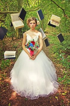 these floating books makes great wedding decor and a whimsical photo backdrop, perfect for the Alice in Wonderland theme at an outdoor venue. {DIY Tip} Gather a collection of old books and using fishing gut or similar, suspend the books from the branches of trees that are strong enough to hold its weight.