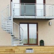 Domestic spiral stair with a large balcony with glass balustrade