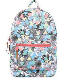 A colorful geo pattern pops against the grey tropical floral print on this mid-size backpack that features ample storage space and a padded laptop sleeve perfect for your carrying needs.