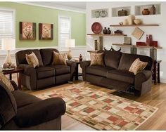 The Megan Snuggler® Recliner sparkles with the latest fashions for today's home. Details include welt trim on cushions and on the rolled arms.