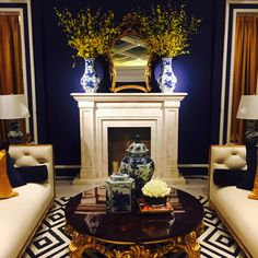 Alissa Sutton Interiors Blue and white porcelain Gold carved sofa Custom designed rug Navy Blue Walls Tufted sofa Fabulous living room