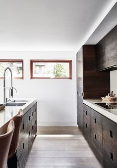 Stylish and modern kitchen with cabinets in smoked oak. The mix of beautiful soft wood from floor to cabinets transform the kitchen into an aesthetic pleasure.