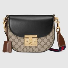 """$1,980.00 GUCCI - Gucci Padlock medium GG shoulder bag - affiliate - A new shape from the Padlock collection, this medium shoulder bag has a flap closure with a key lock pulled straight from the archives. The key is placed in a leather key case that loops around handle.  material with low environmental impact  Gold-toned hardware  Blue and red nylon   Web shoulder strap  Interior open pocket  Shoulder strap with 20"""" drop  Lock closure"""