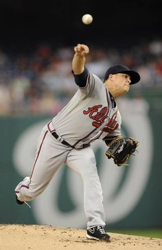 Atlanta Braves starting pitcher Kris Medlen delivers against the Washington Nationals during the first inning of a baseball game.