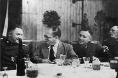 SS officers gather for drinks following the dedication of the new SS hospital in Auschwitz.  Pictured from left to right Richard Baer, Dr. Carl Clauberg and Karl Hoecker.