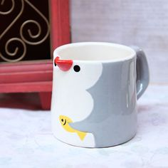 Can't go wrong with a penguin mug....oh, how I want this....Love penguins!