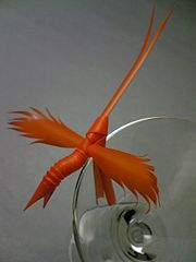 Display the bird on a glass by putting the rim between the two legs.