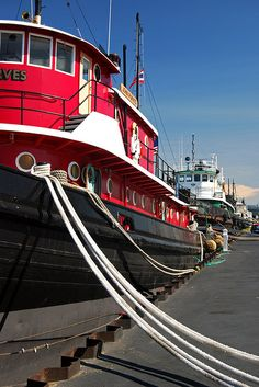 """The recently restored tugboat """"John Purves"""" docked alongside other tugs in Sturgeon Bay, Wisconsin.     You can take a tour of it through the Door County Maritime Museum."""