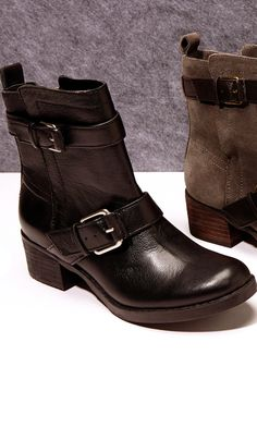 Motorcycle boot with buckles, pull tab at back heel, side zipper and stacked heel.