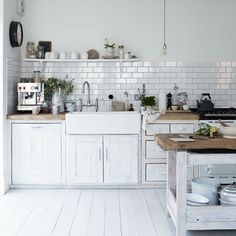 I love white kitchens, subway tile and farm sinks. We have that espresso machine!