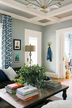 If you're having trouble deciding on a paint color for trim work, keep in mind that white is ideal for houses with unique trim work. The white paint used on this ceiling's classic beams commands attention and draws the eye upward.