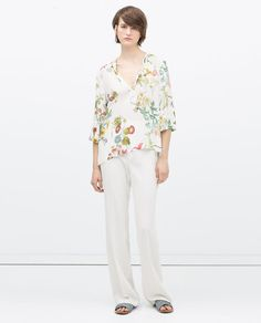 Image 1 of PRINTED TOP WITH UNEVEN HEM from Zara