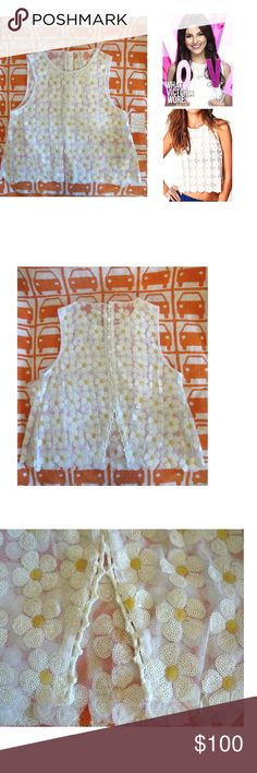 Free People Daisy Sequin Tank Top Victoria Justice As seen on Victoria Justice! Super adorable. Sheer mesh tank top with sequined daisy pattern all over. Crochet Peter Pan collar in front. Buttons up the back. Scalloped bottom hem. 100% Polyester. 18.5 L. Size XS. **No trades** Free People Tops Tank Tops