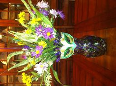 My Mardi Gras arrangement.  Added garland, silk flowers and mask from Michaels to a vase I already had.