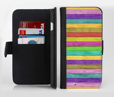 The Thin Neon Colored Wood Planks Ink-Fuzed Leather Folding Wallet Credit-Card Case for the Apple iPhone 6/6s, 6/6s Plus, 5/5s and 5c from DesignSkinz