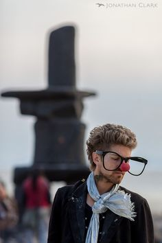 man-with-large-glasses-and-red-nose-at-temple-of-whollyness-burning-man-2013-cargo-cult-black-rock-city-playa-jonathan-clark