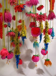 """yarn, ribbon & feather flowers -- this would make an adorable """"bead"""" curtain for your little princess or a frilly fairy room."""
