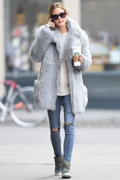 A basic crewneck sweater, distressed skinny jeans, sneakers, sunglasses, a venti-something, and a fur, coat? Yea. Yep, thanks OP. You've stepped it up a bit.
