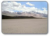 In the Alvord Desert on the Alvord Playa looking at the Steens escarpment.