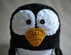 Crochet Penguin Hat with Ear Flaps (Various sizes available). $15.00, via Etsy.