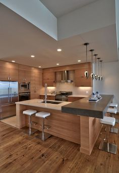 Elegant-Contemporary-Kitchen-Designs-You-Need-To-See-1 - using stools & counters instead of DR table -oak cabinets