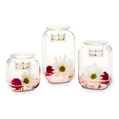 """Clearly Creative™ Classic Votive Trio  Item #:  P92264 Classic shape gives this blown glass trio a retro look. Fill with what you love then top with votive or tealight candles, sold separately. One holder in each height: 6¼""""h, 5""""h, 3½""""h."""
