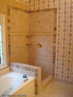 Perfect match diagonal tiles in corner. Is there a reason he cut the inside…