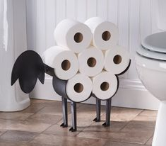 """Promising Review: """"I absolutely love this sheep toilet paper holder! I was sick of trying to find space in our bathroom closet to store extra rolls of TP. This seemed like the perfect solution! It's made very well, easy to assemble, and has brought a bit of functional whimsy into an otherwise boring room. I appreciate the fact that it can be free-standing or hung on the wall. Seriously, if I could give this thing 10 stars, I would! It's sooooo cute!"""" —DeanokatPrice: $44.99"""
