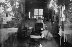 Robert Frank. Barber shop through screen door – McClellanville, South Carolina, 1955