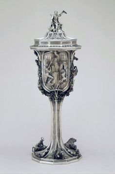 Hunting scene cup. Eagle hunting, snake hunting, lion hunting. Hunter with chamois as Lid coronation. Goldsmith Henry II Fries, Zurich. Silver, raised (goldsmith technique), embossed, chased, cast, partially gilded. Dated 1849.