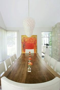 Love this - with the intense pop from the artwork.  Simple room makes the table shine as a piece of art as well.