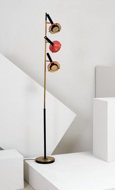 Oscar Torlasco; Brass and Enameled Metal Floor Lamp for Lumi, 1950s.